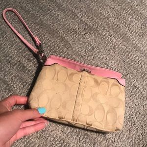 Coach wristlet with baby pink detailing